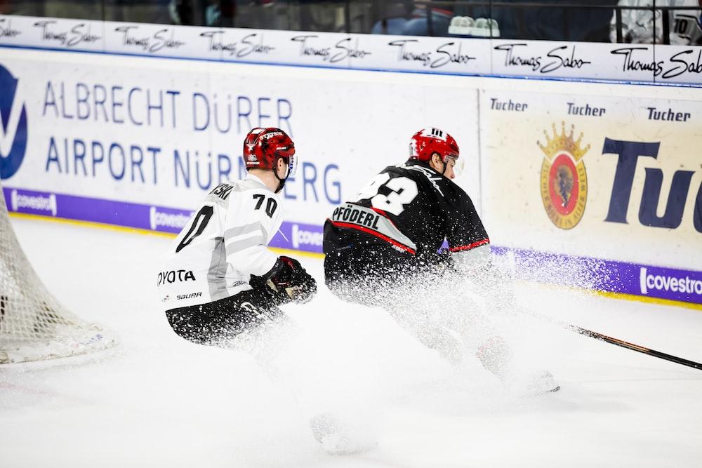 two hockey players in hockey stadium