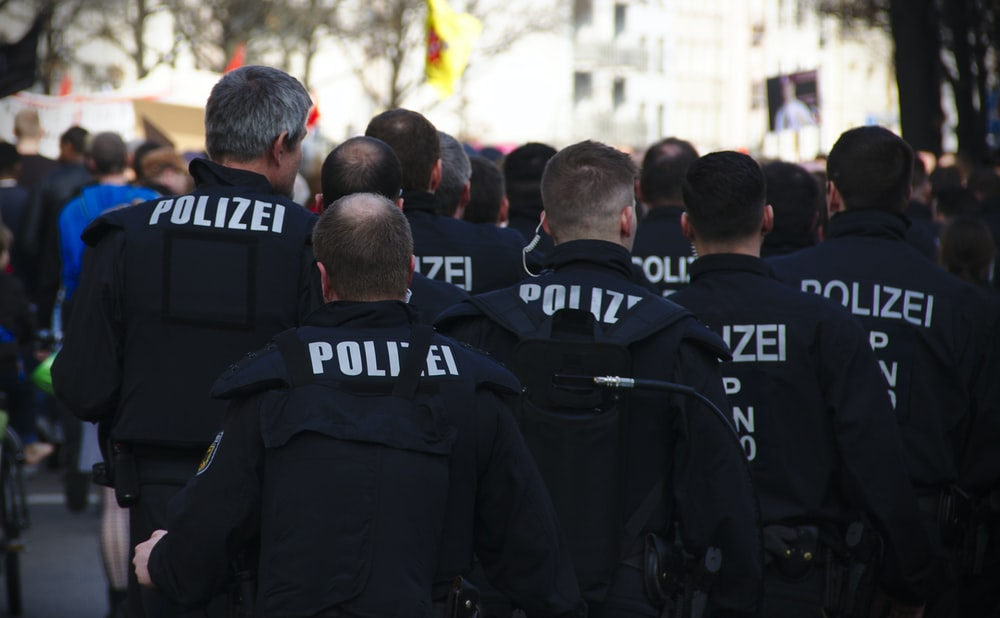 police standing on road during daytime