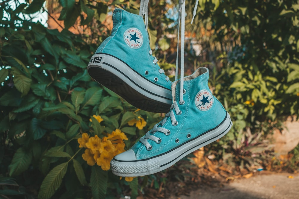 pair of teal Converse All-Star high-tops