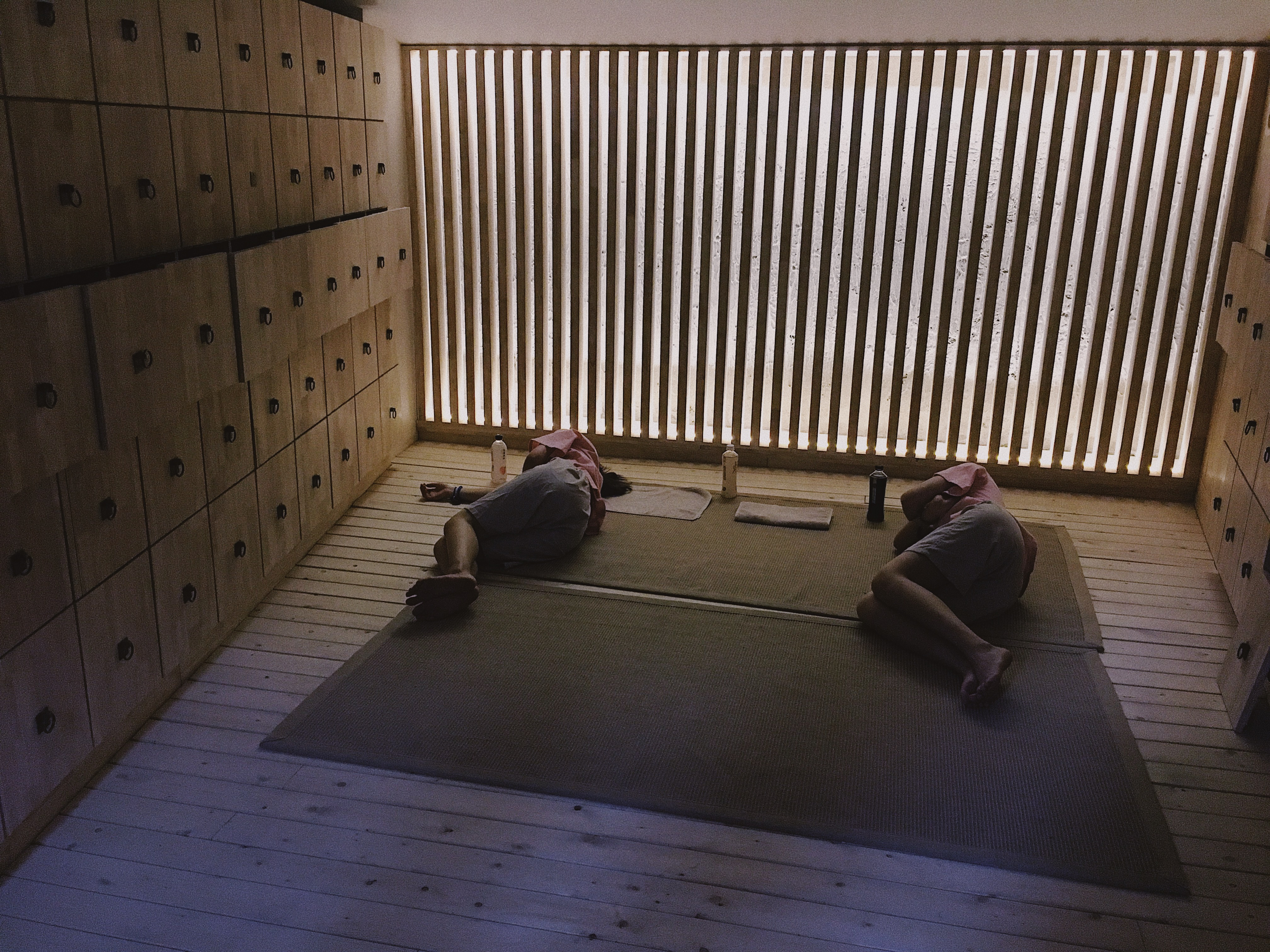 two person lying on area rug
