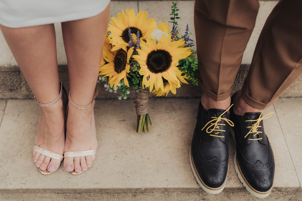 sunflowers between man and woman on staircase