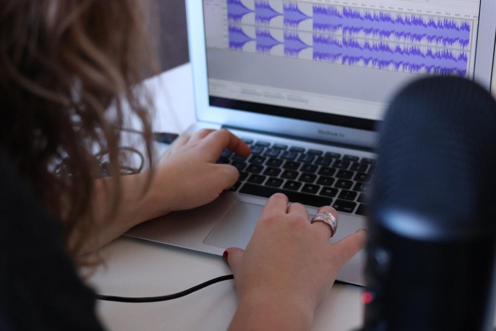 woman using MacBook Air in room