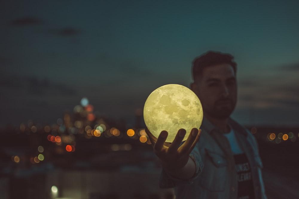 man holding moon lamp
