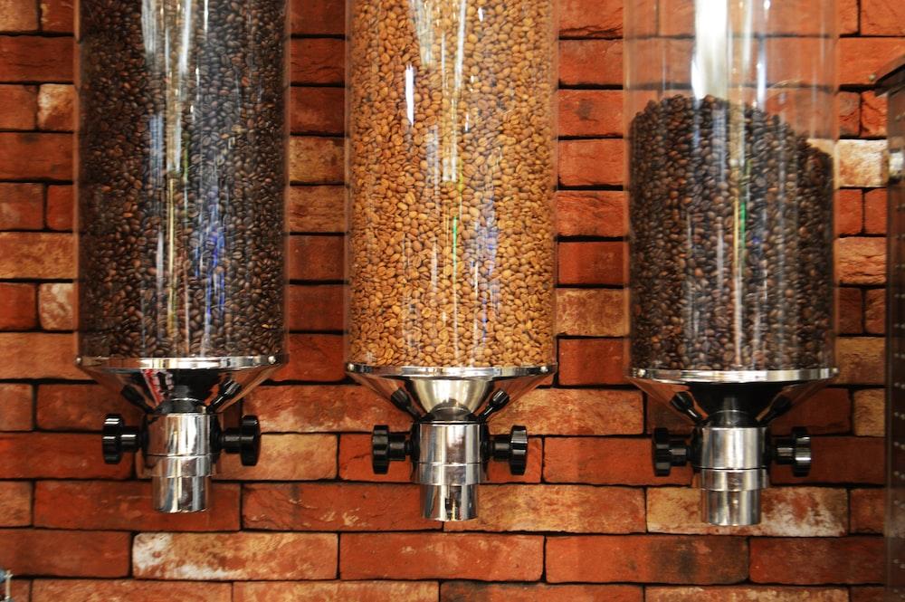 view of three varieties of coffee beans inside coffee dispensers