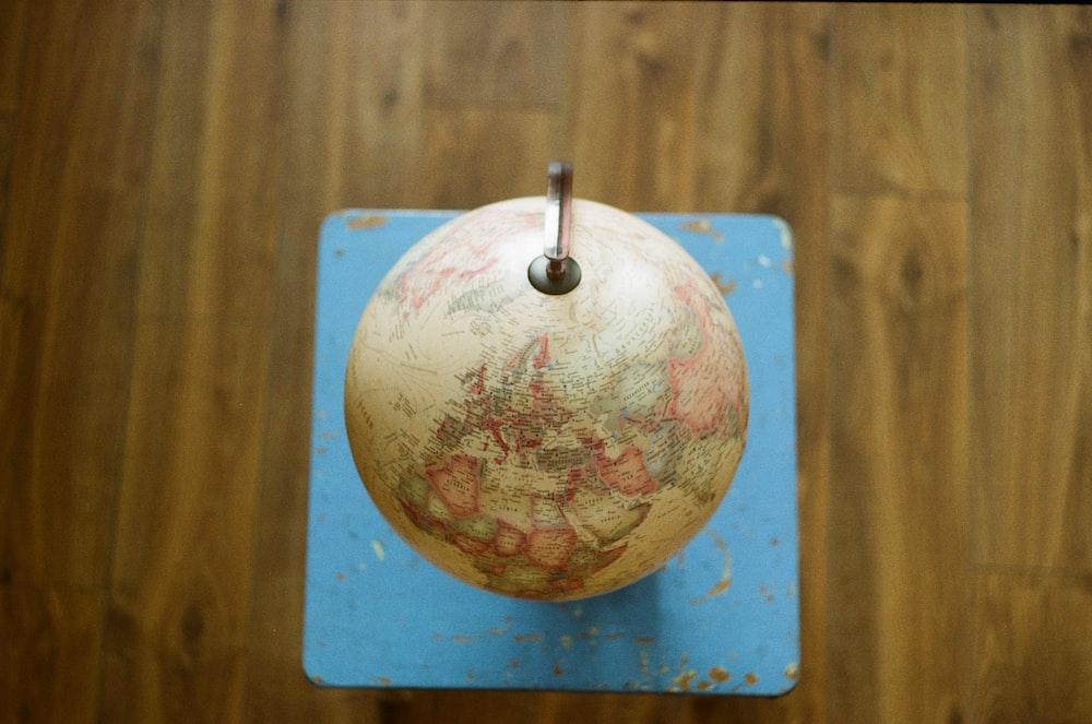 desk globe in wooden board