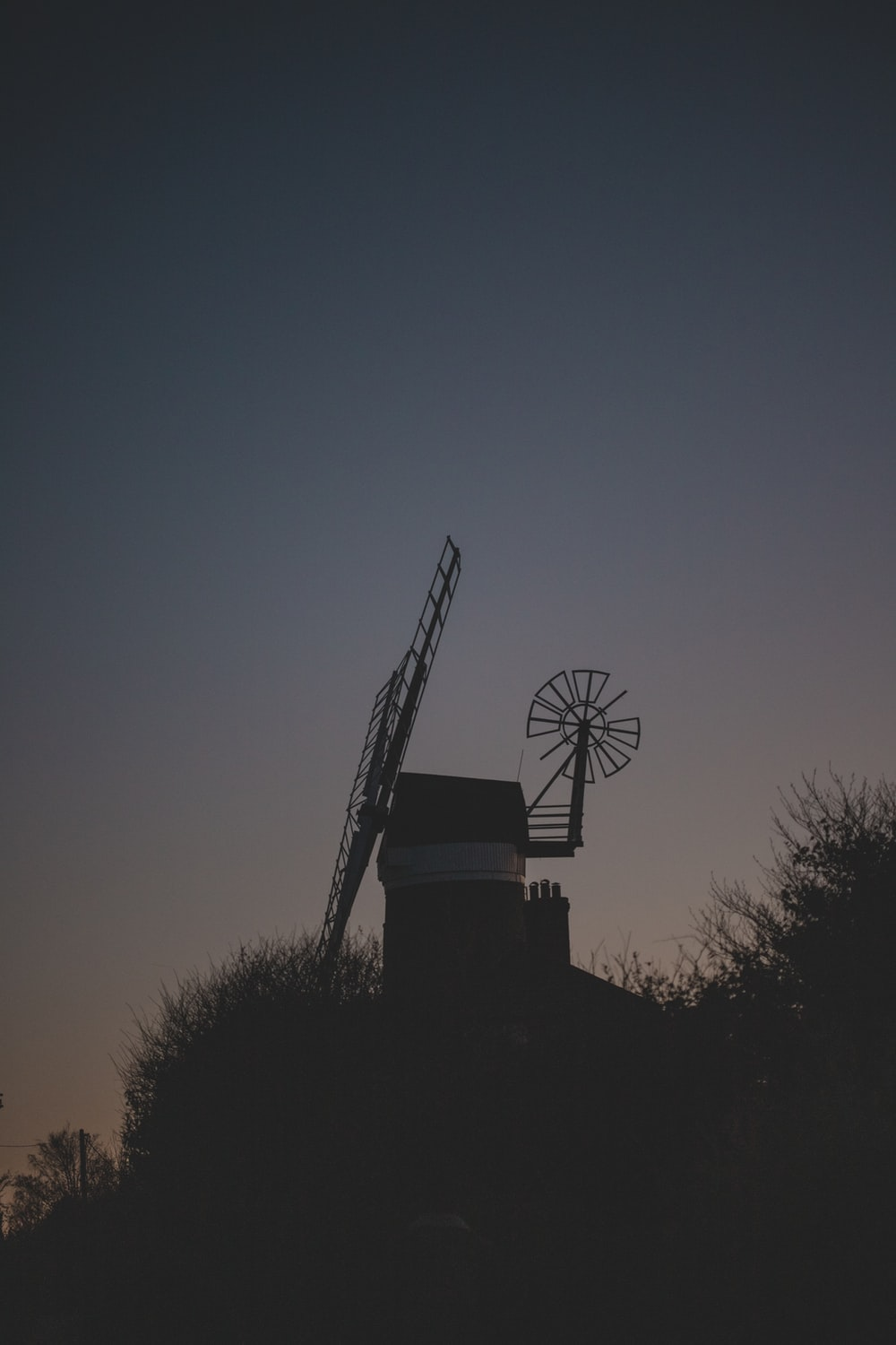 silhouette photography of windmill