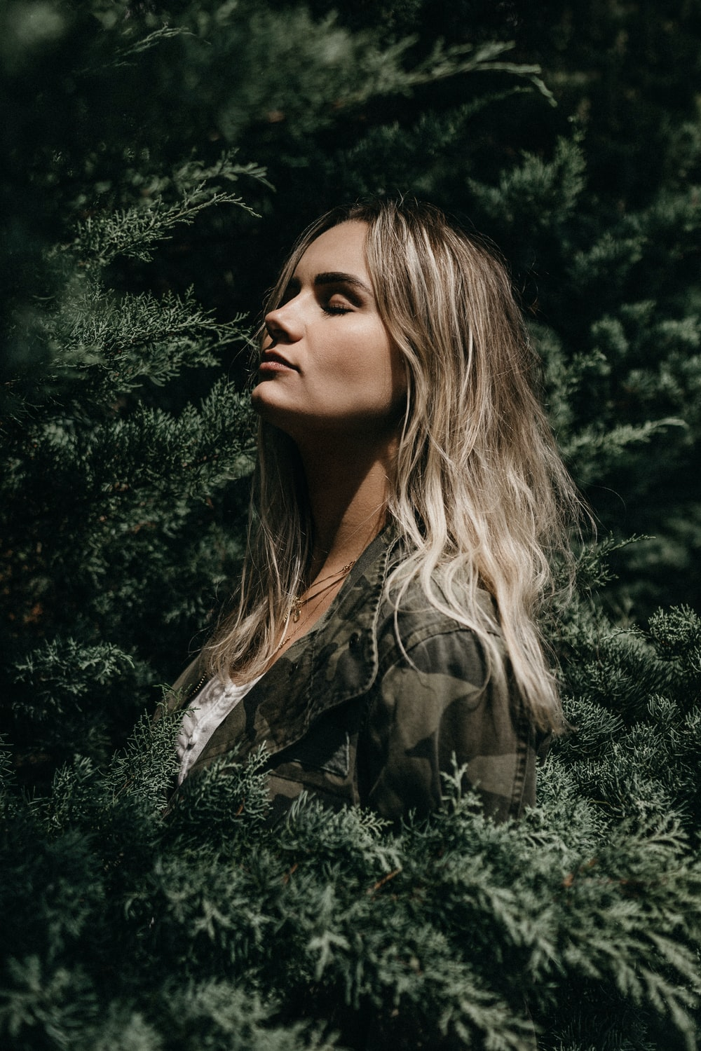 woman in woodland camouflage on trees