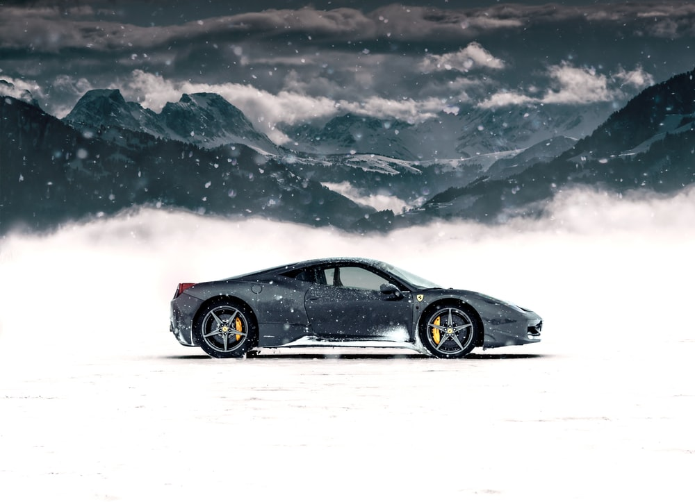 gray coupe on snow