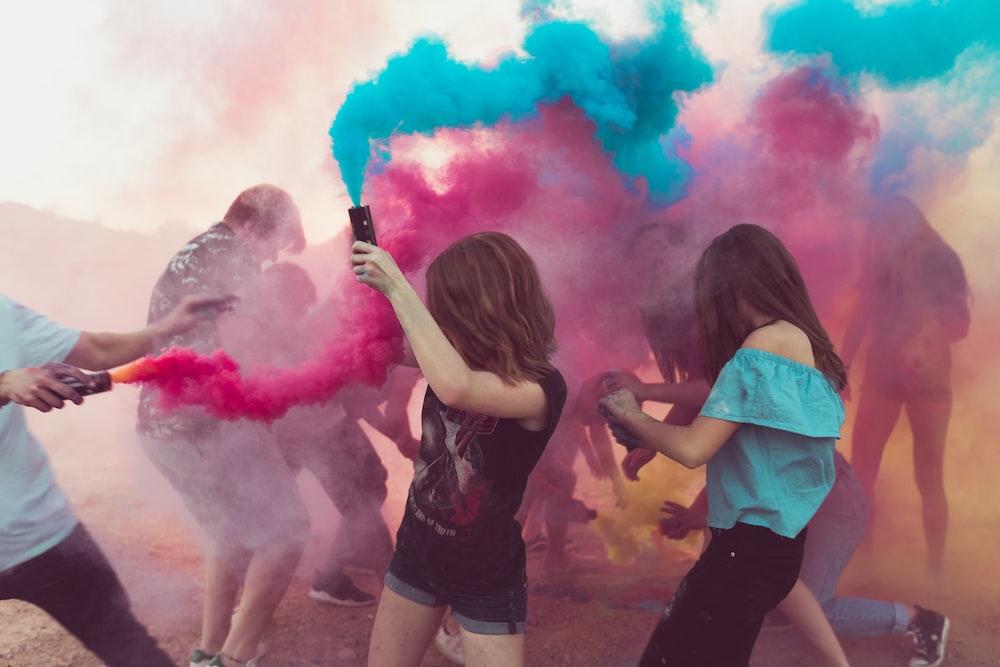 people spraying powder