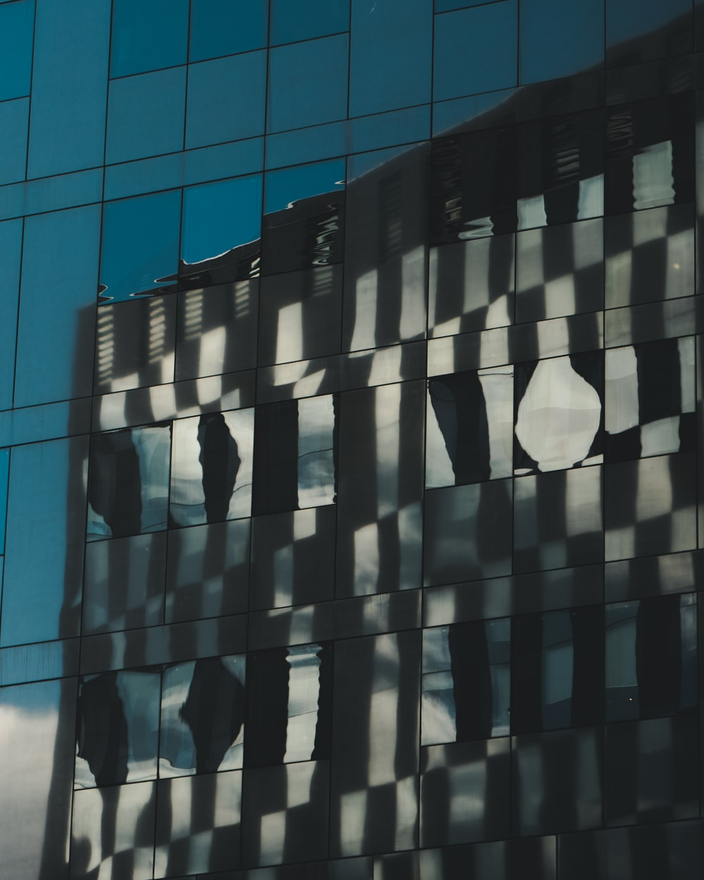 reflection of high rise building