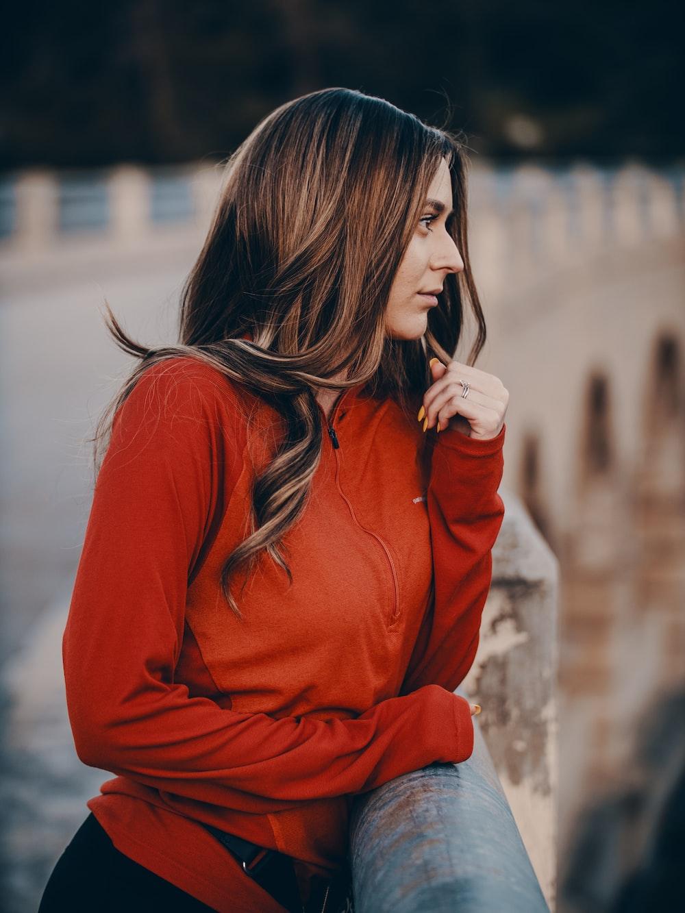 woman wearing orange zip-up hoodie