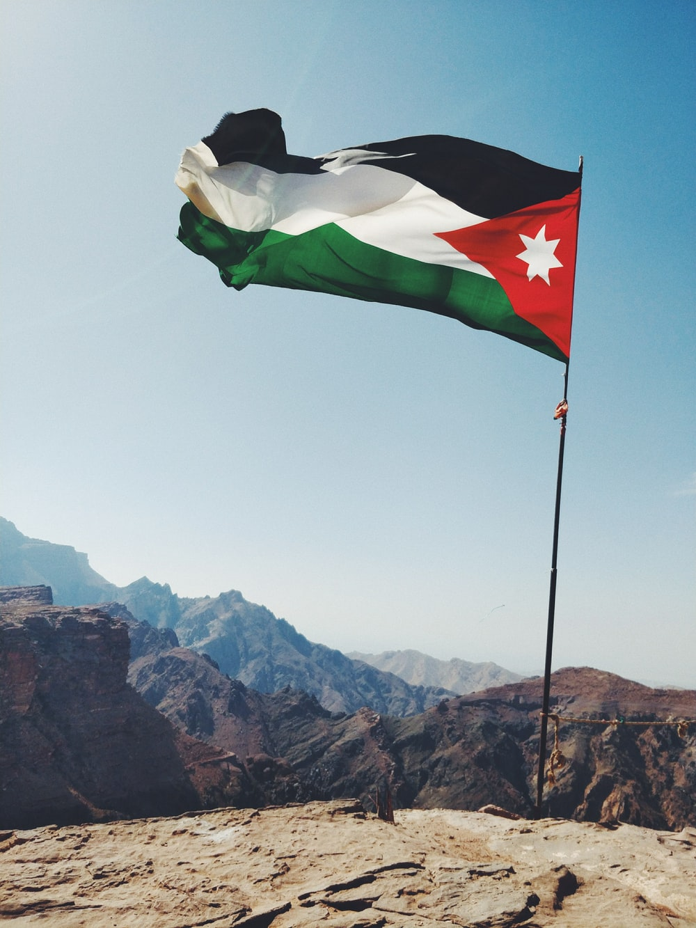 Jordan flag on rock formation