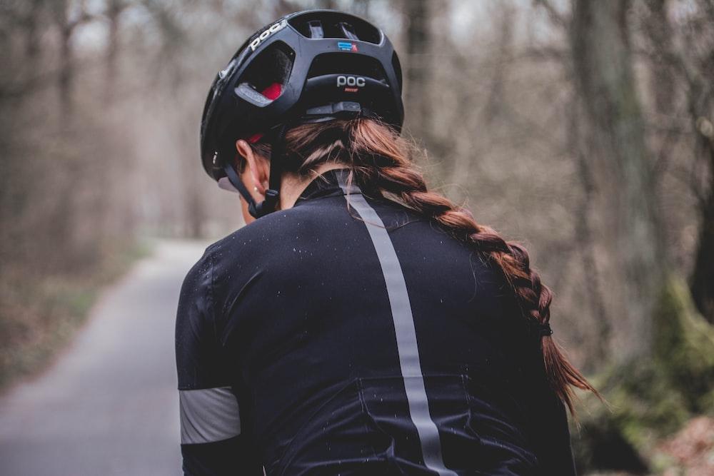 woman in black POC cycling helmet