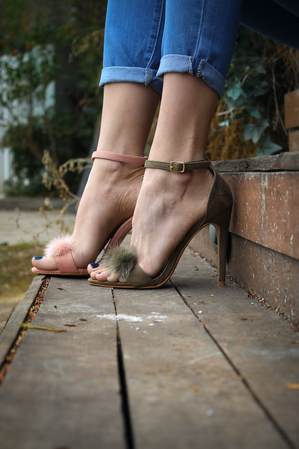 person wearing brown and pink stilleto
