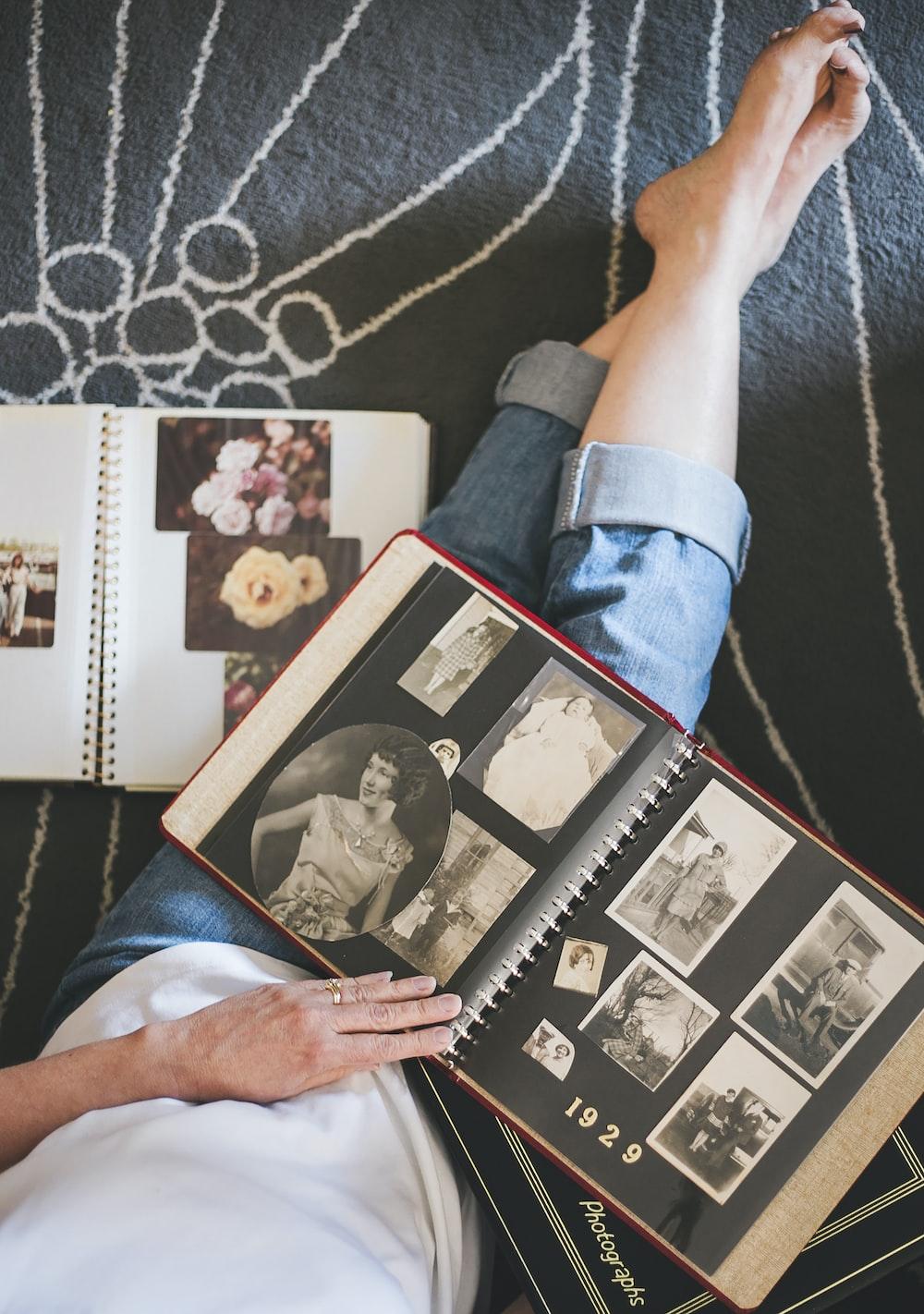 woman looking photo album