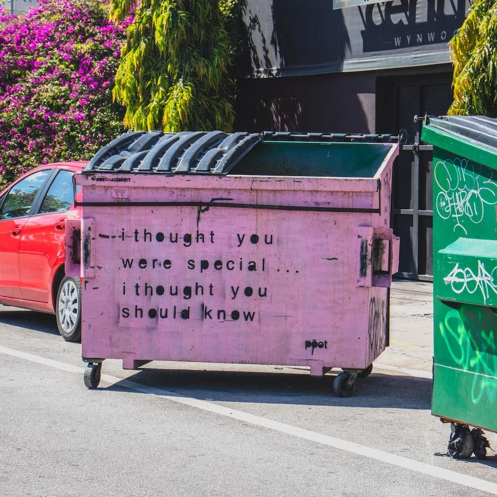 purple and black trashcan