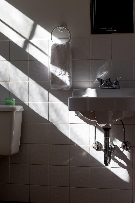 hanged towel beside sink