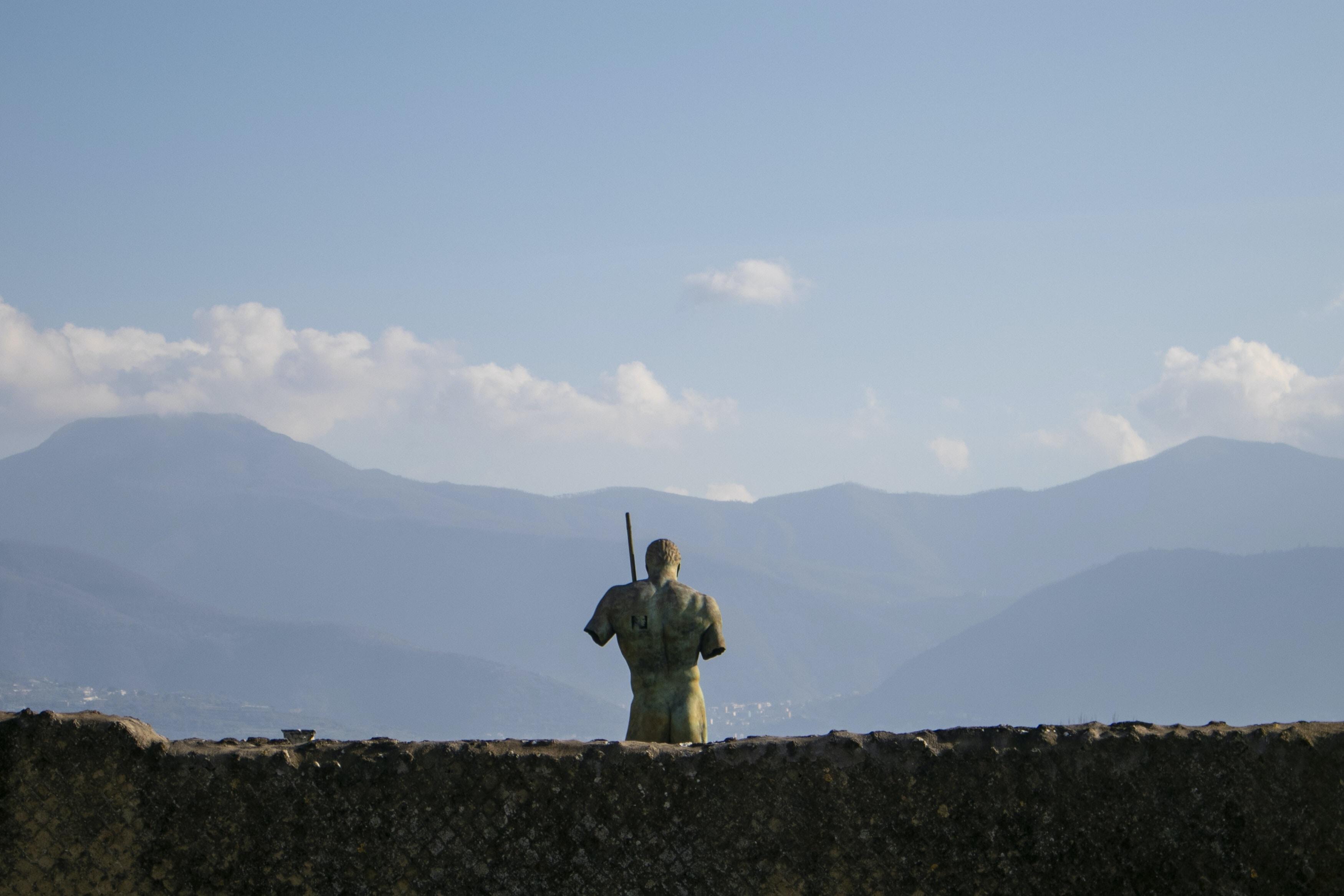 man standing behind wall