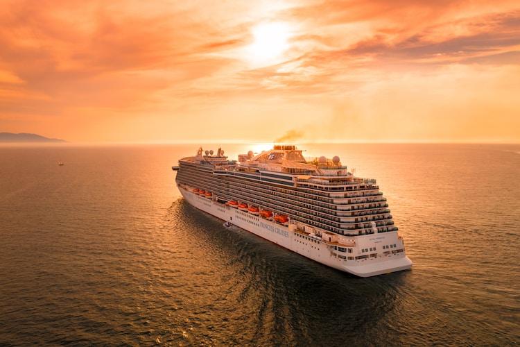 white ship on sea during sunset