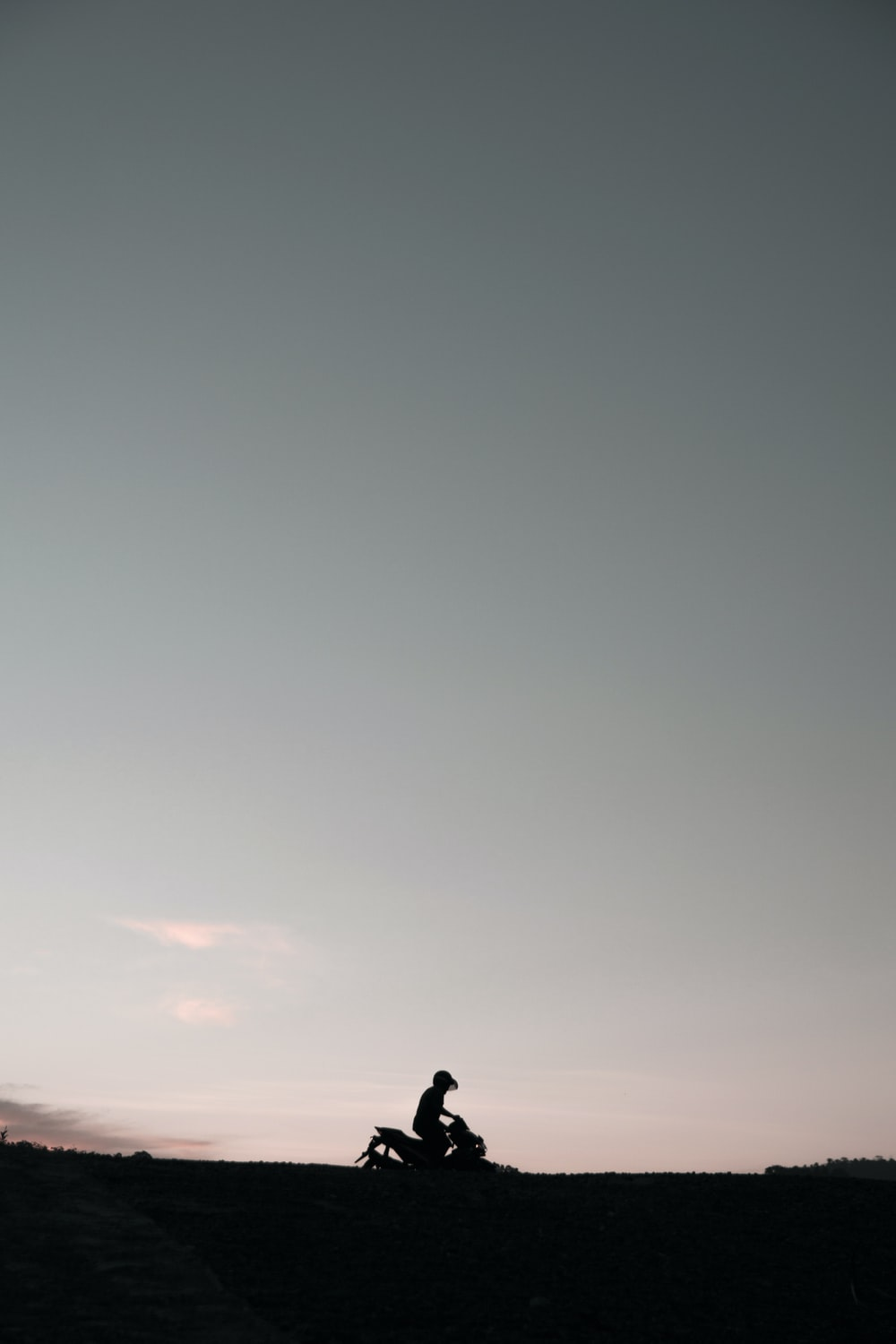 silhouette of person riding motorcycle