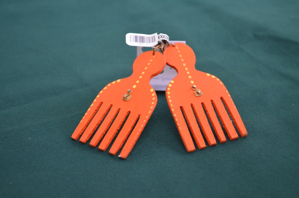 pair of red fork accessories on gray textile