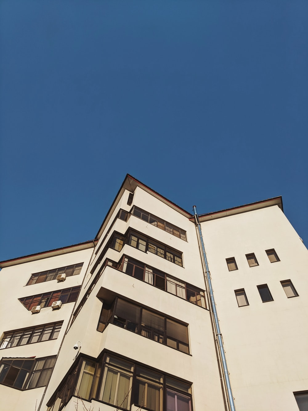 low-angle photography of white high-rise building