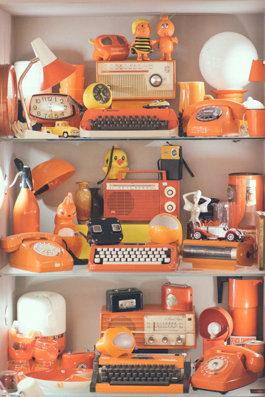 assorted orange appliances lot on display