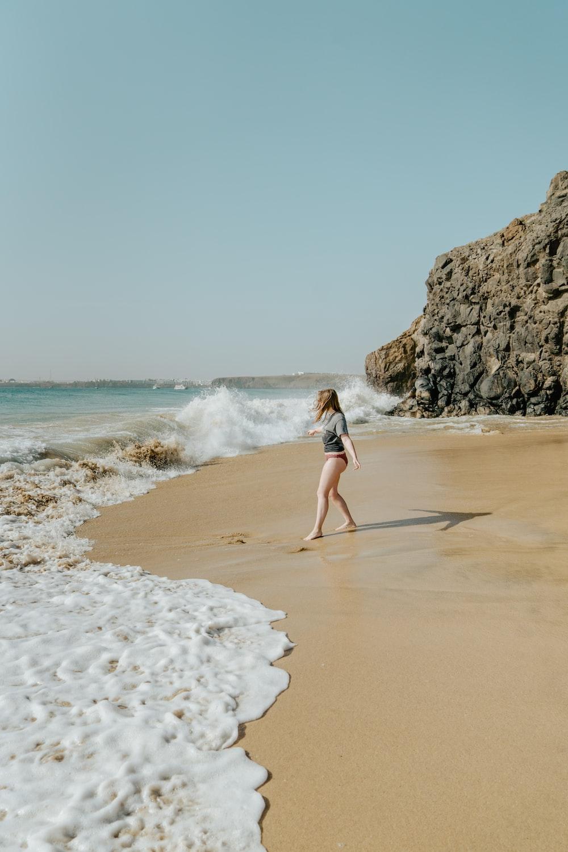 woman beside seashore during daytime