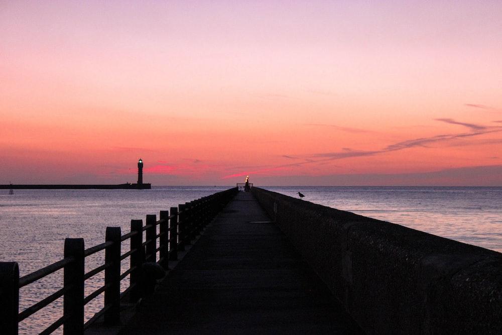 black dock during golden hour