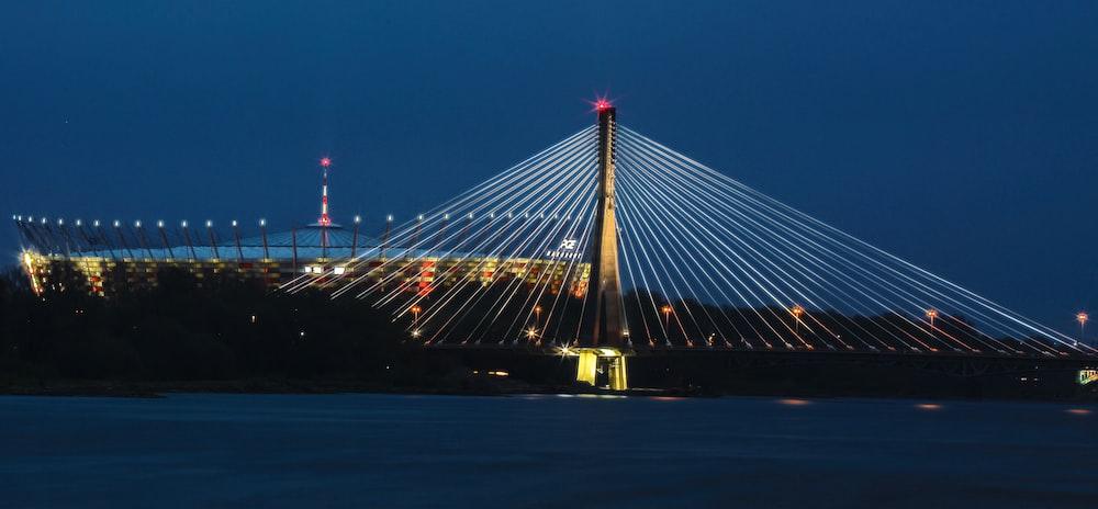 suspension bridge with lights at night