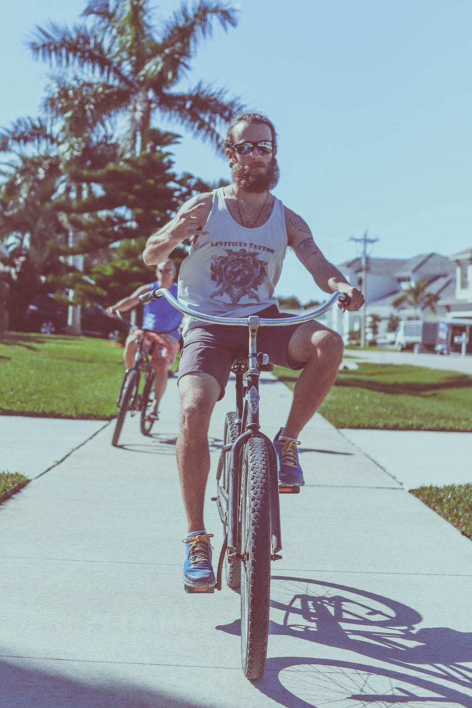 man riding a cruiser bike