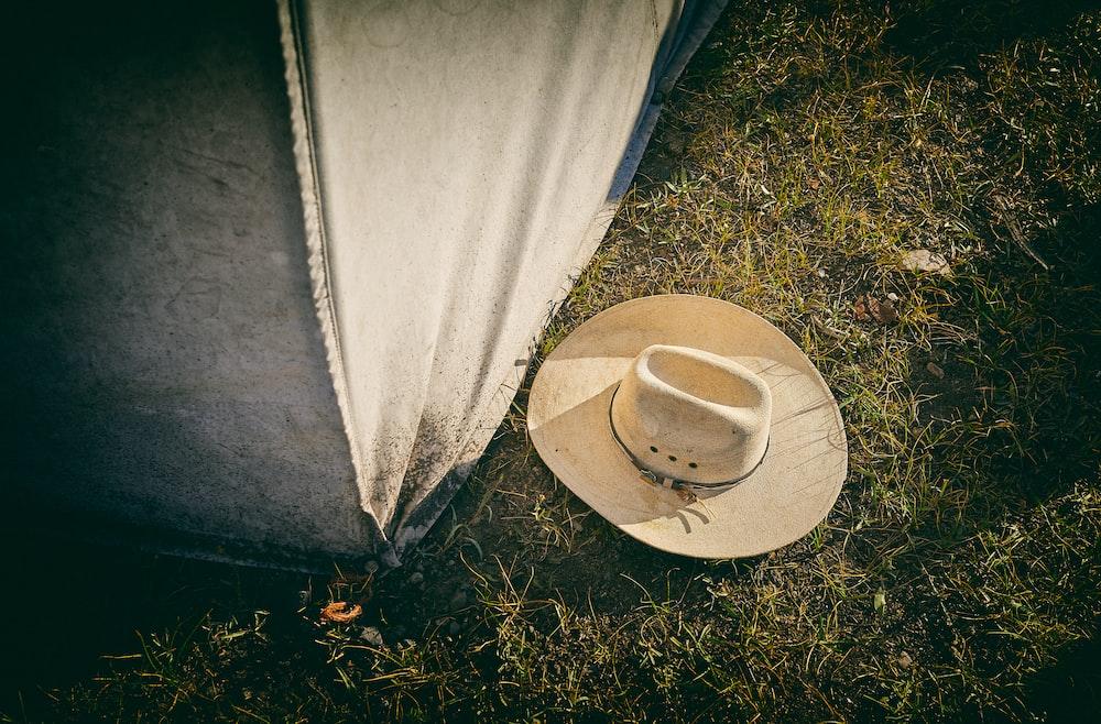beige cowboy hat close-up photography