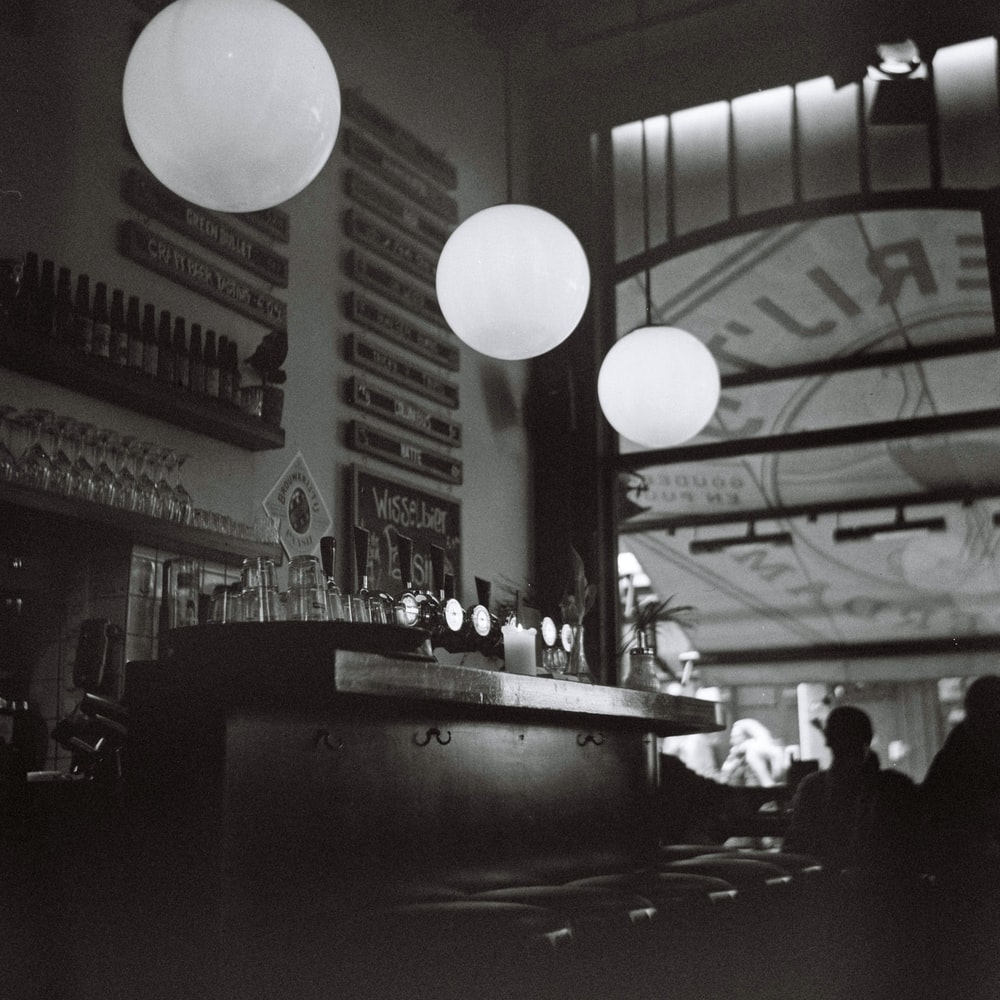lighted round hanging lamps in bar