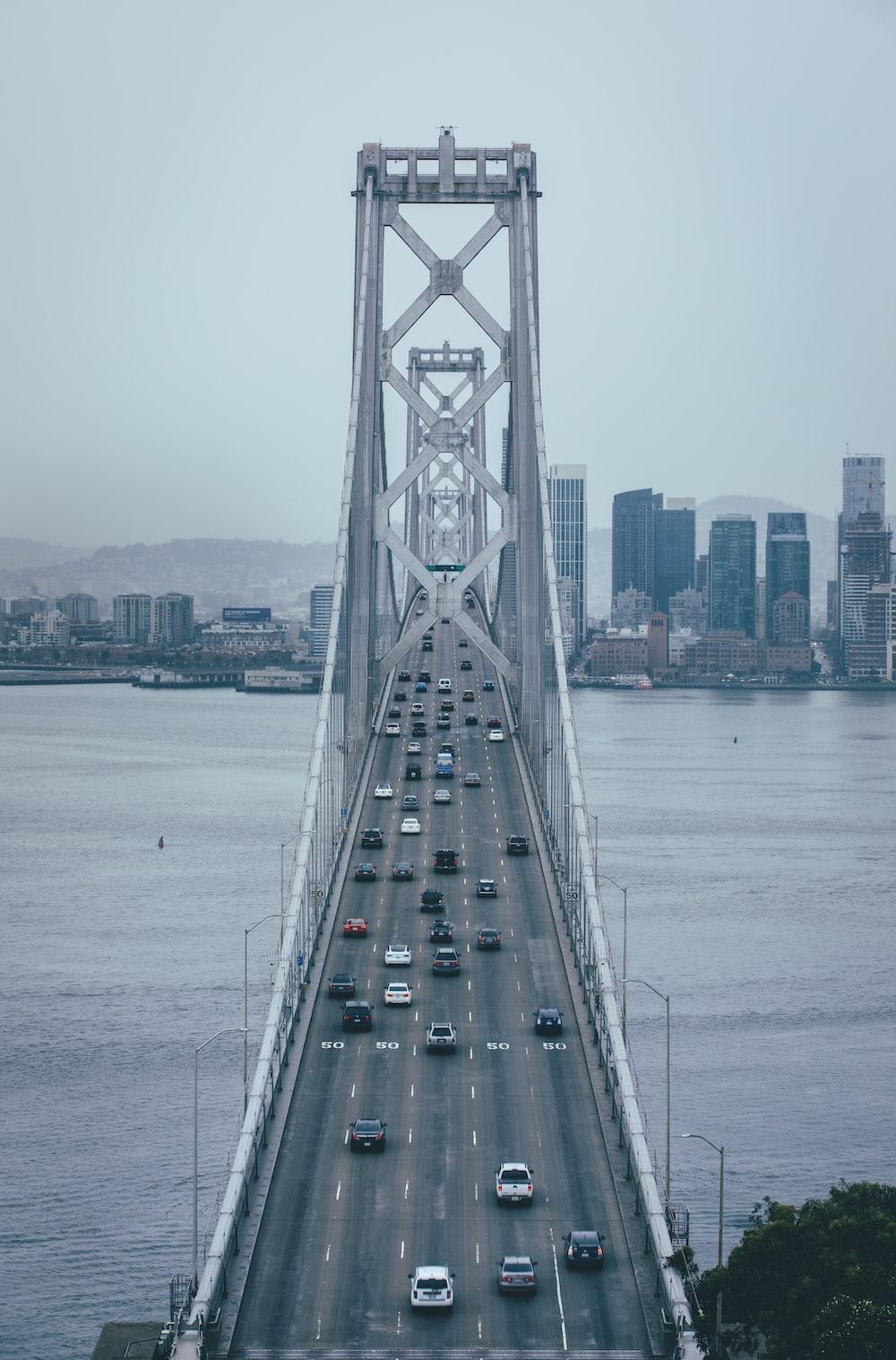 vehicles on bridge at daytime