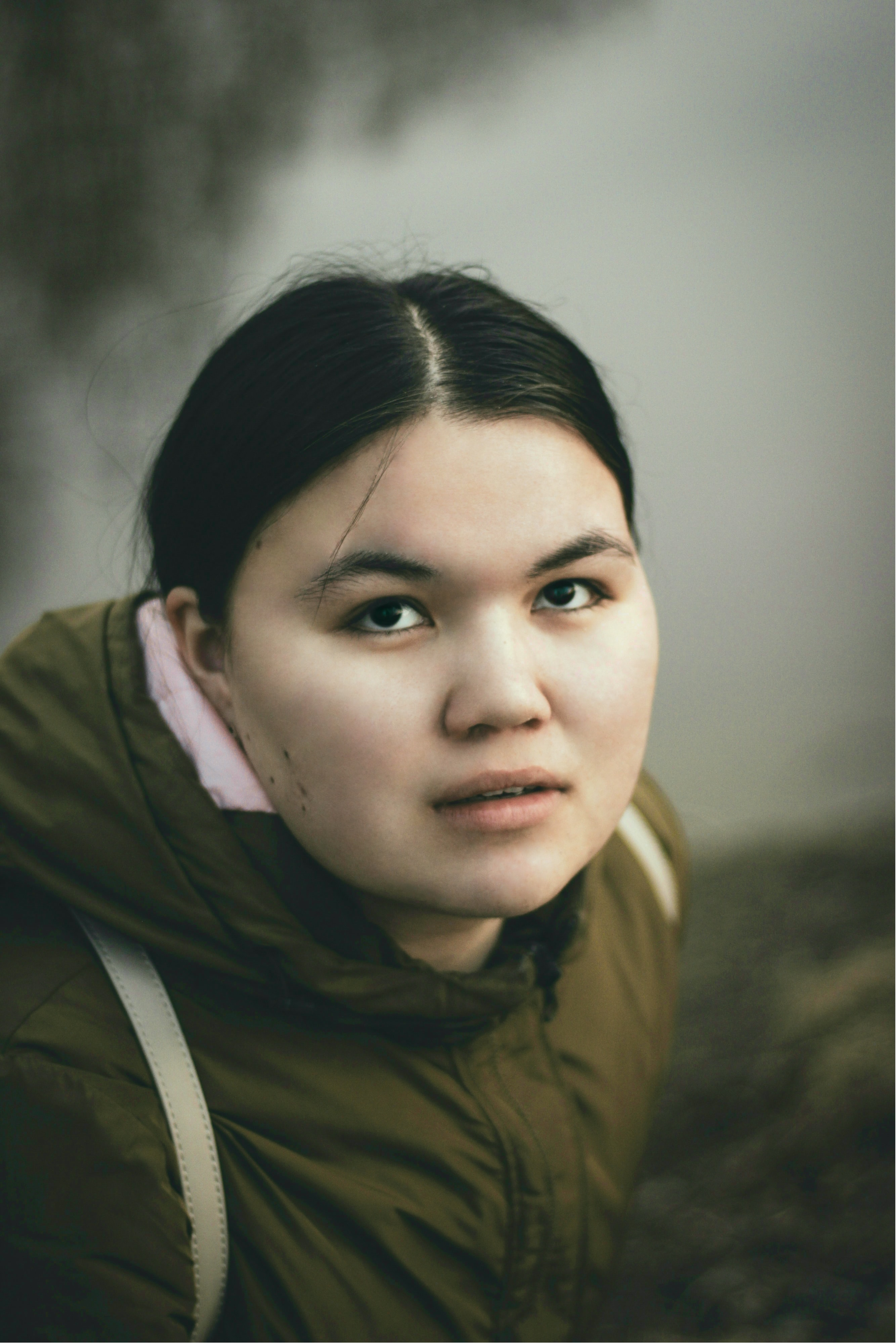selective focus photography of woman wearing brown hoodie