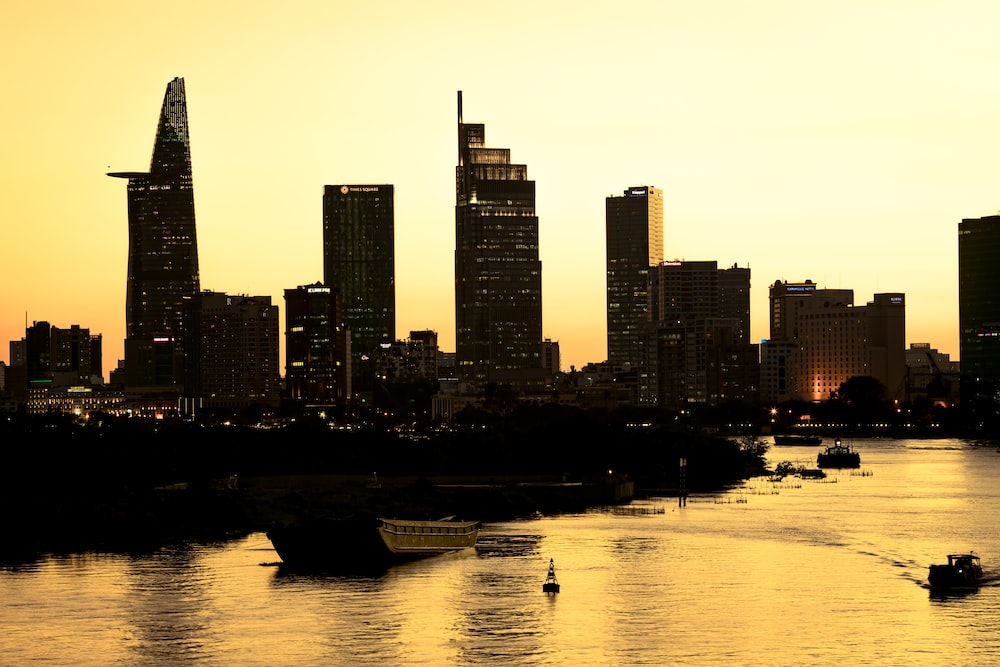 silhouette photo of high-rise buildings and canal