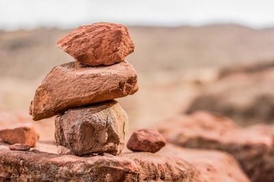 stacked brown rocks rock zoom background