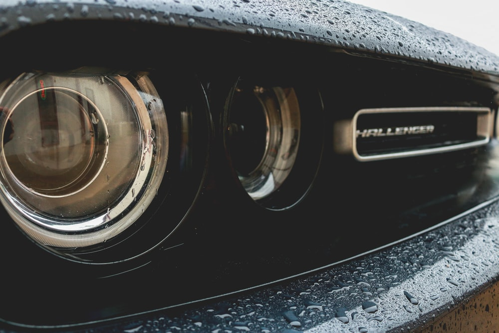 close-up photography of vehicle headlight