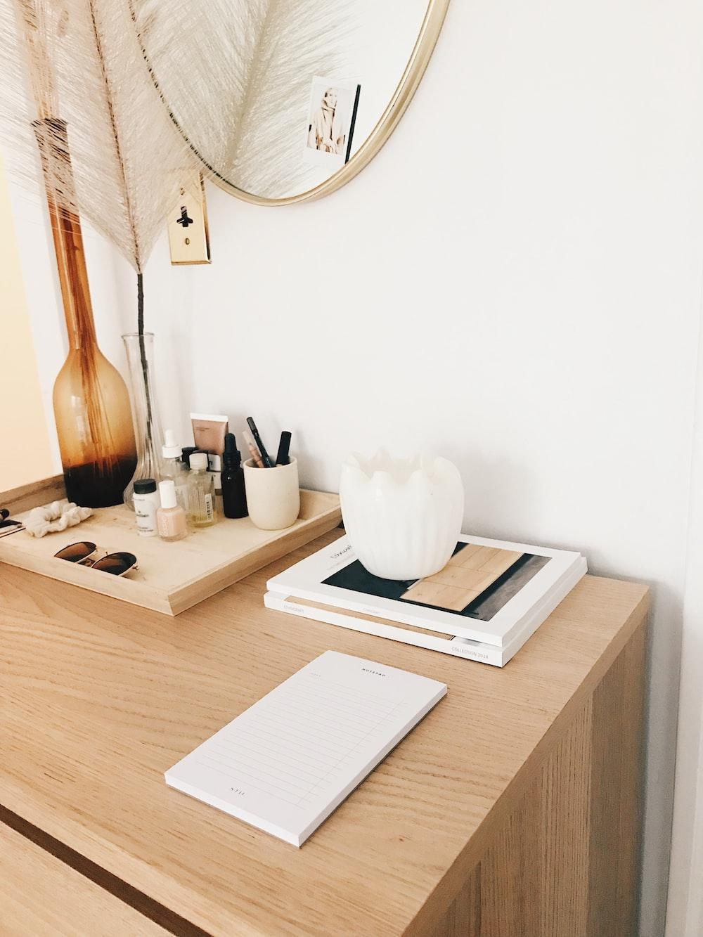 amber glass flower vase near white wall-mounted socket