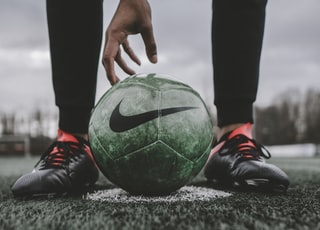 person standing in front of Nike soccer ball