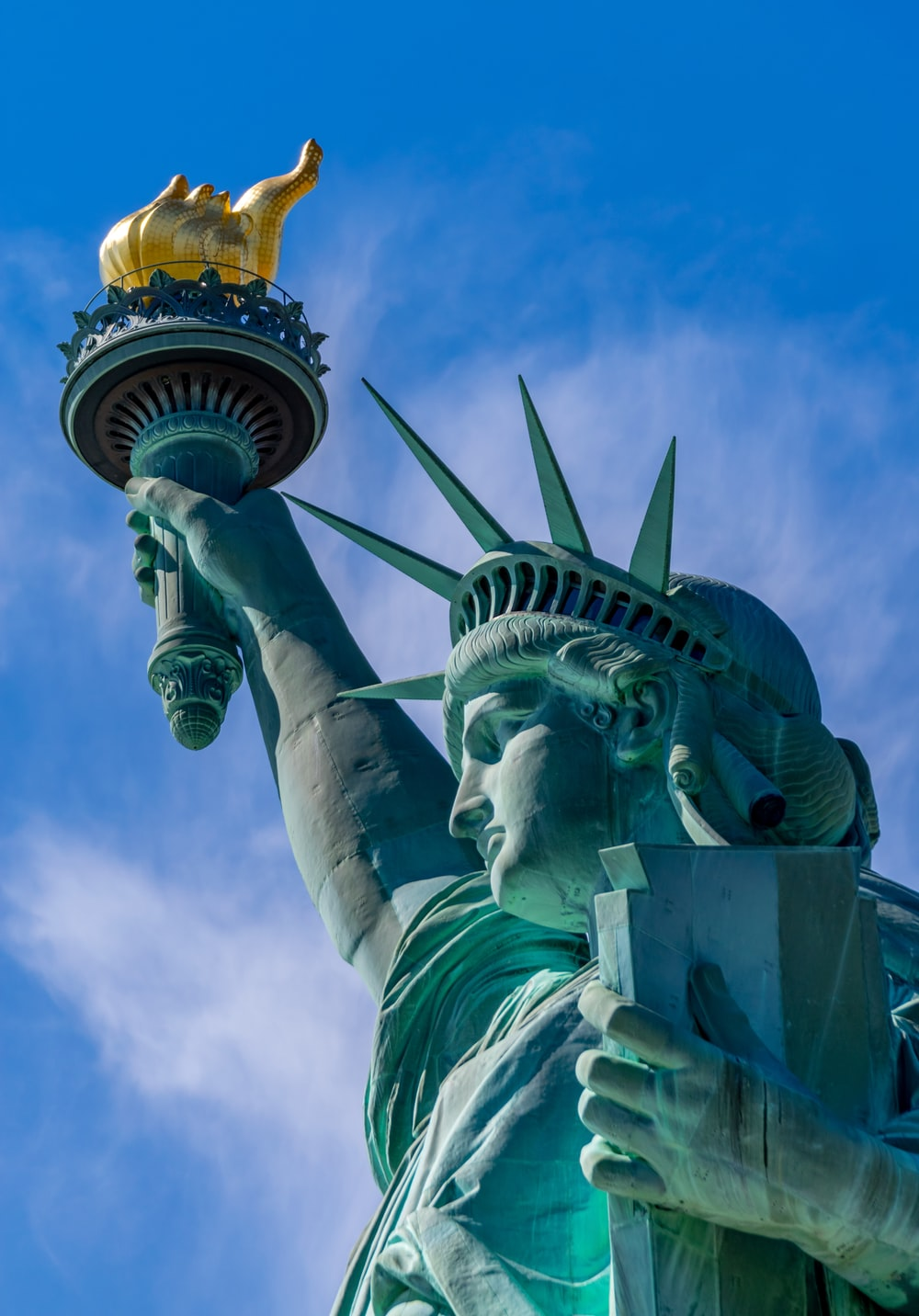 Statue of Liberty during daytime close-up photography