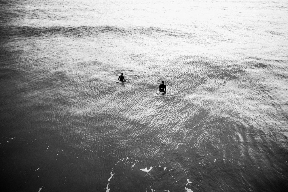 aerial view photography of two person on body of water