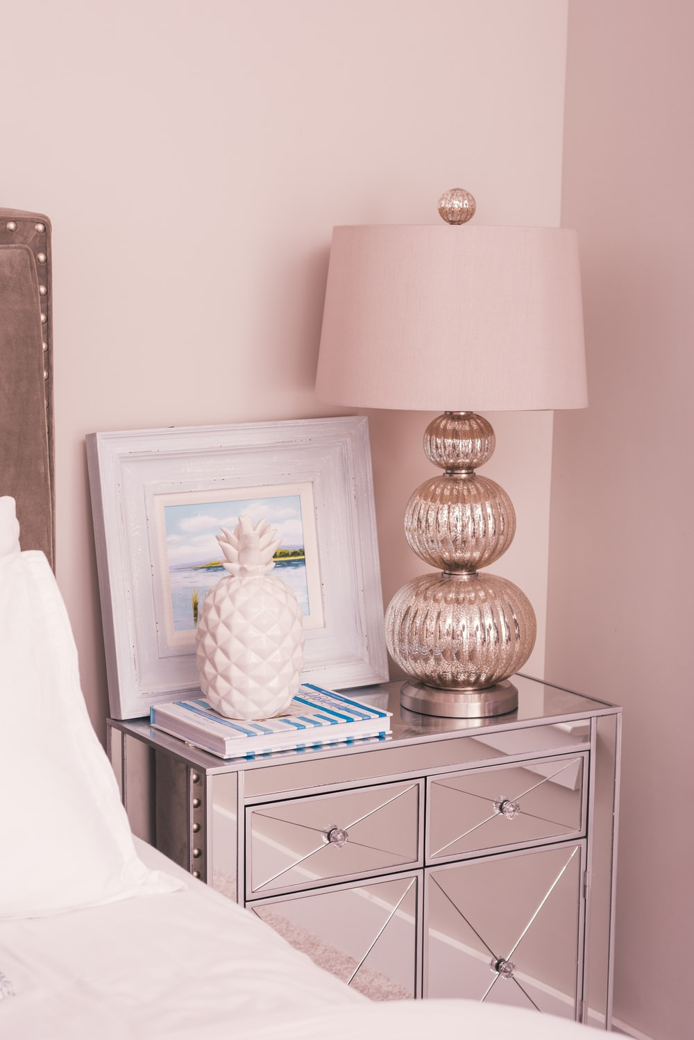 white and silver-colored table lamp