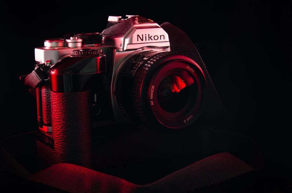 photo of black and gray Nikon DSLR camera