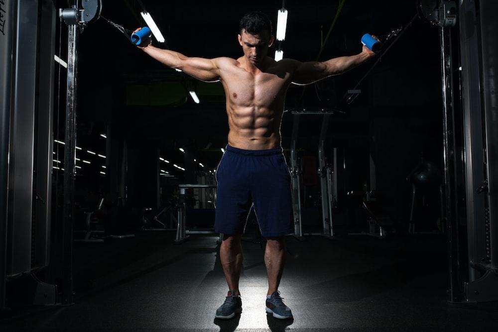 man exercising inside dim room