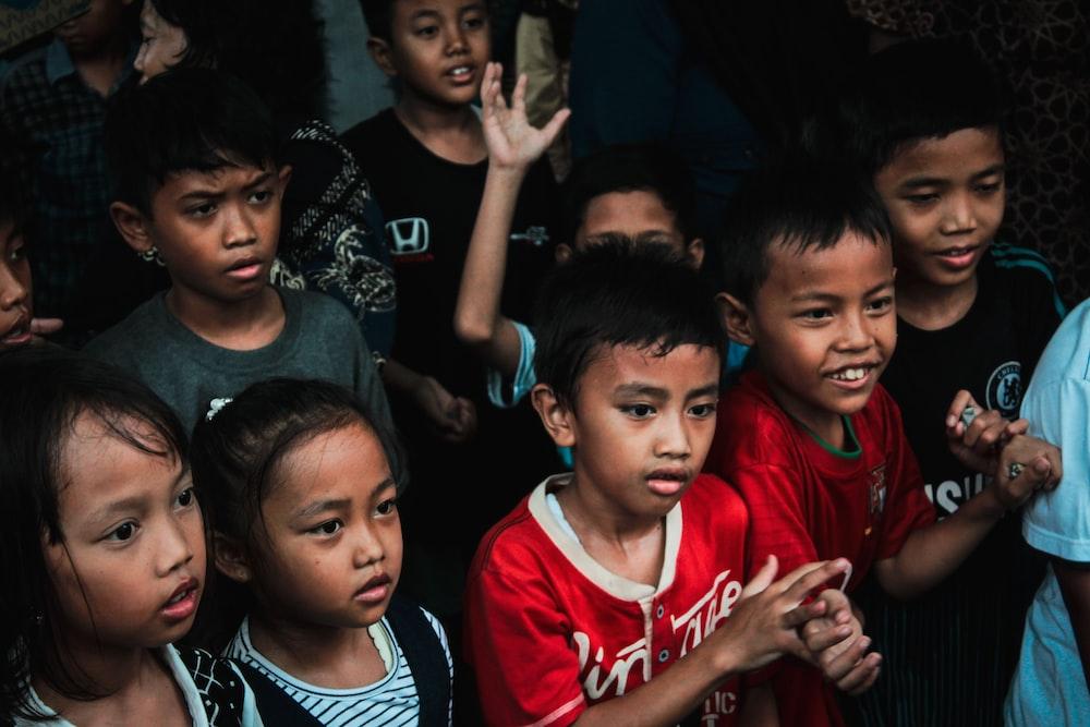 children standing on floor