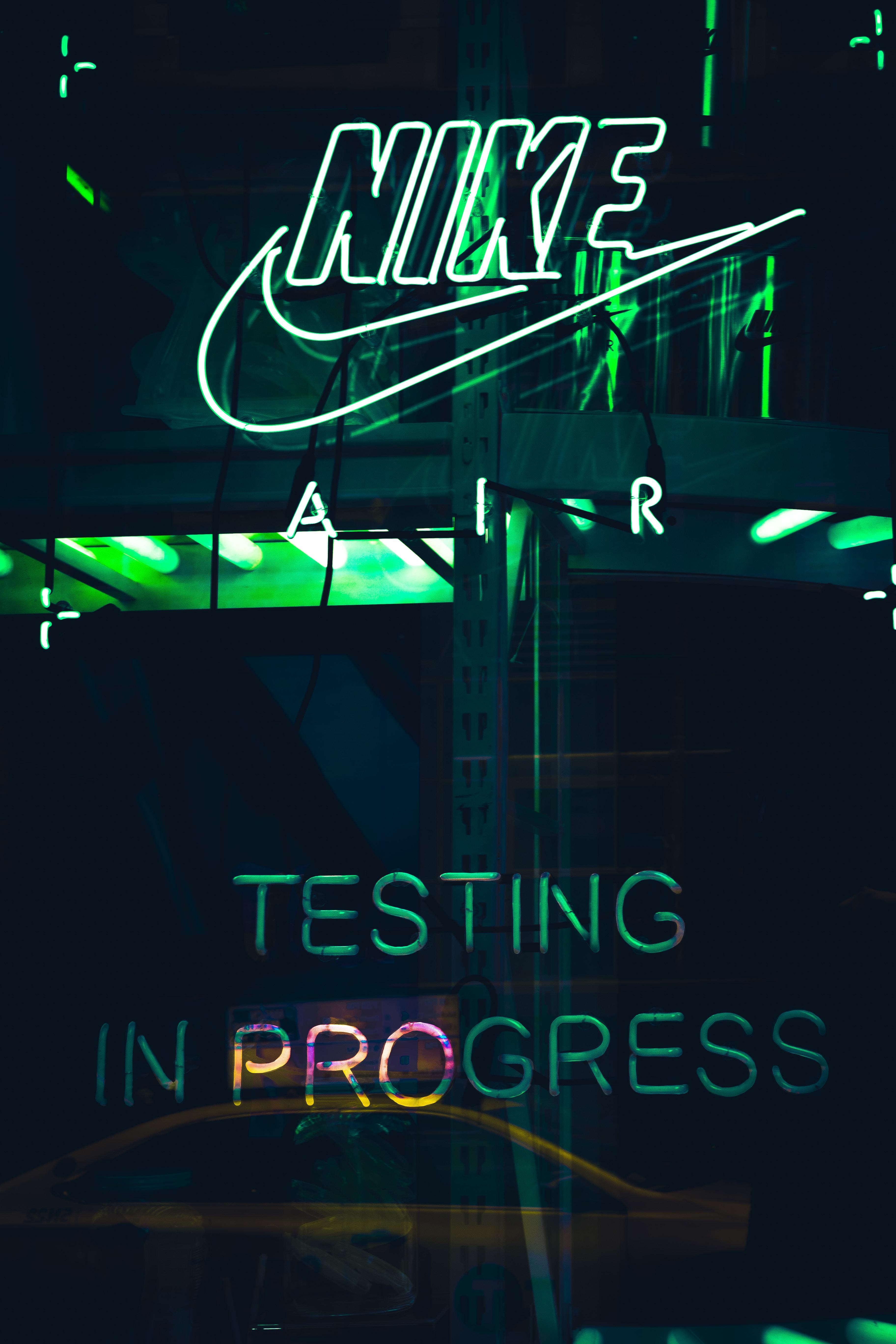 turned-on white Nike neon light signage