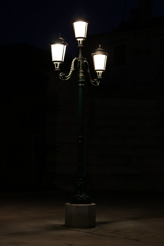 black 3-upright street lamp