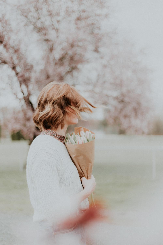 woman holding bouquet flower
