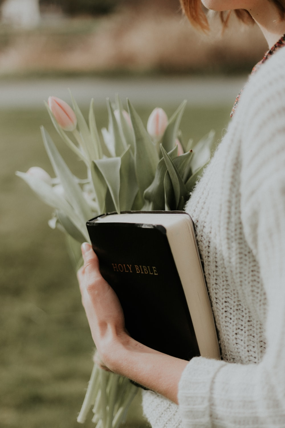 woman holding Holy Bible